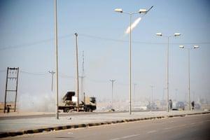 Ajdabiya, Libya : Rebel fighters launch rockets from the western gate, Ajdabiya