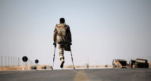 Ajdabiya, Libya : A one-legged Libyan rebel fighter walks on the road, Ajdabiya