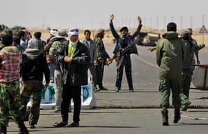 Ajdabiya, Libya : A rebel fighter shouts to other soldiers, Ajdabiya