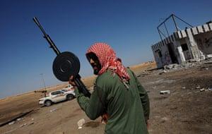 Ajdabiya, Libya : A Libyan rebel fighter holds a machine gun, Ajdabiya