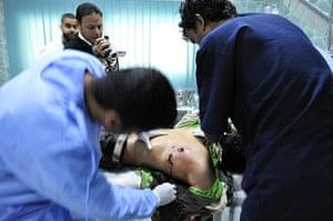 Ajdabiya, Libya : A rebel soldier being treated for gun shot wounds, Ajdabiya