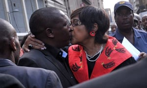 Julius Malema is embraced by Winnie Madikizela-Mandela outside the high court in Johannesburg