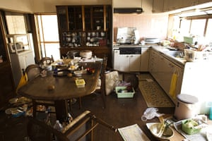 Fukushima exclusion zone: 12 April: A dining room and kitchen sits empty in Futaba Town