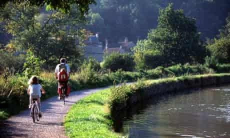 Cyclists on towpath Bath to Bradford on Avon canal