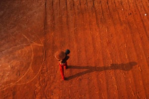 24 hours in pictures: A child labourer in a laterite mine in India