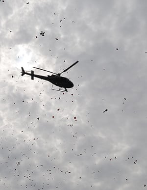 24 hours in pictures: A police helicopter throws flower petals Tasso da Silveira School in Rio