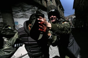24 hours in pictures: An injured riot policeman in La Paz