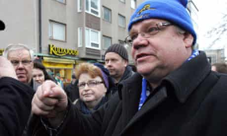 True Finns party leader Timo Soini speaks with supporters in the western town of Pori