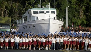 Bay of Pigs anniversary: Cuban children march next to a replica of the Granma