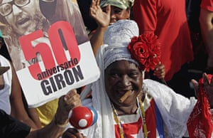 Bay of Pigs anniversary: A woman smokes a cigar while marching in the parade