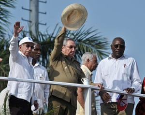 Bay of Pigs anniversary: Cuban President Raul Castro, centre, waves