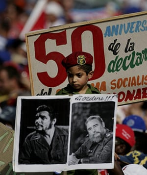 Bay of Pigs anniversary: A boy dressed as a Cuban soldier watches a parade
