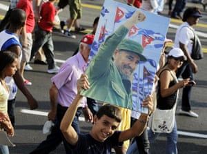 Bay of Pigs anniversary: A youth holds a picture of Cuban former president Fidel Castro