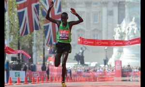 Kenya's Emmanuel Mutai crosses the finishing line to win the men's London Marathon