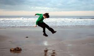 Schoolboy on beach