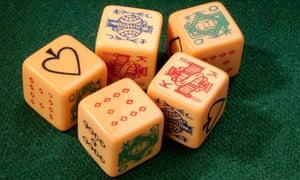 poker dice on green baize