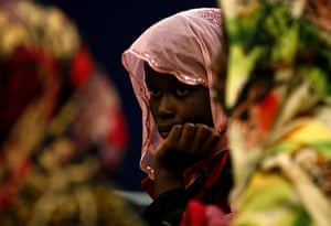 Misrata, Libya : A Ghanaian migrant worker waits to disembark in the port of Benghazi