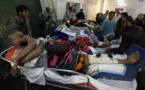 Misrata, Libya : Injured Libyan men are lined up to be moved toward waiting ambulances