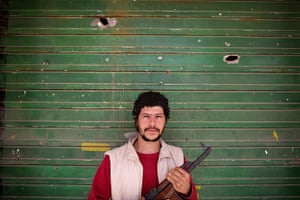 Misrata, Libya : Libyan shop owner who became a rebel stands in front of his shop