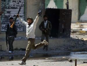 Misrata, Libya : Libyan rebel celebrates in relief after crossing Tripoli street,  Misrata