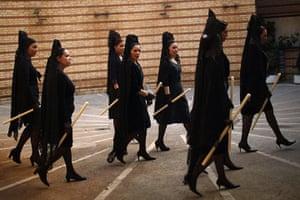Holy Week in Malaga: Women wearing traditional mantilla dresses during Holy Week in Malaga