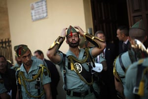 Holy Week in Malaga: Spanish legionnaires prepare for a change of honour guard