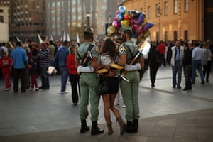 Holy Week in Malaga: Spanish legionnaires pose for a photo with a woman during Holy Week