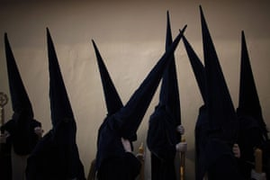 """Holy Week in Malaga: Penitents take part in the procession of """"Estrella"""" brotherhood"""