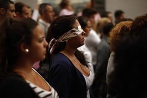 Holy Week in Malaga: A penitent walks blindfolded