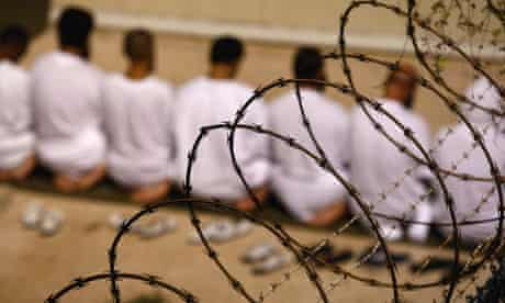 Guantanamo inmates kneel at prayers