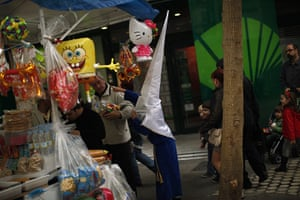 from the agencies: A penitent stands next a kiosk of toys during Holy Week in Malaga