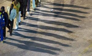 Misrata, libya:: Sub-Saharan African nationals wait to board an ferry