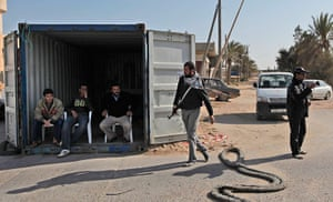 Misrata, libya:: Libyan rebel fighters guard near a checkpoint