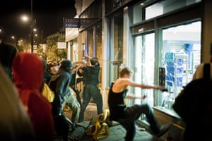 Tesco riots in Bristol: People smash the windows of the newly opened Tesco Express supermarket