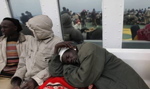 Misrata Libya: A foreign evacuee sleeps on deck of the Ionian Spirit ferry
