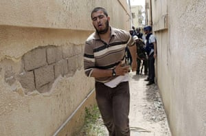 Misrata Libya: A wounded Libyan rebel fighter runs during house-to house fighting