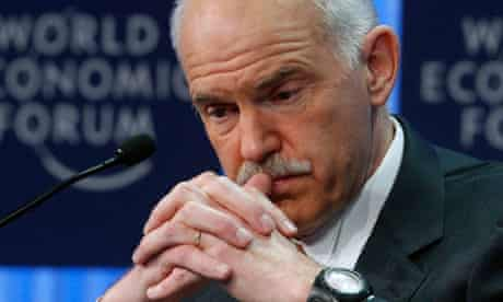 Greek Prime Minister George Papandreou attends a session at the WEF in Davos