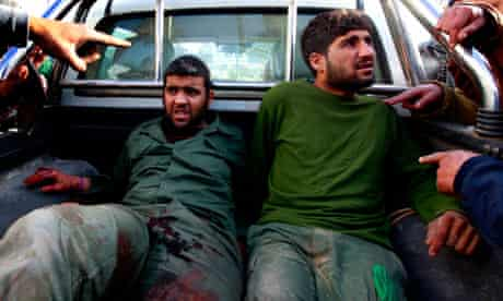 Gaddafi soldiers are brought by rebels to Misrata hospital in the back of a pick-up truck