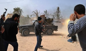 Libyan rebels fire at forces loyal to Gaddafi in the Zwabi district of Misrata