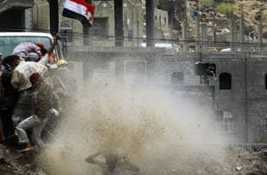 24 hours in pictures: Police use water cannon on anti-government protesters in Taiz, Yemen