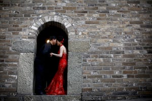 24 hours in pictures: A couple have their wedding photos taken on the Great Wall of China