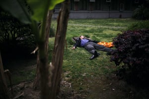24 hours in pictures: A man sleeps in the garden of the Art Museum of Shanghai