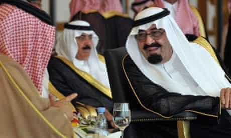 Saudi King Abdullah speaks Bahrain's King Hamad bin Isa al-Khalifa on the outskirts of Riyadh
