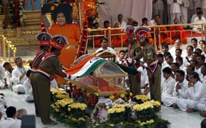 Sai Baba funeral: Police place India's national flag on a glass coffin
