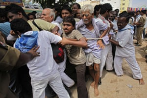 Sai Baba funeral: Security personnel try to control followers as they throng to the ashram