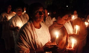Sai Baba funeral: Devotees hold a candle light vigil as at the Parasathi Temple in Durban