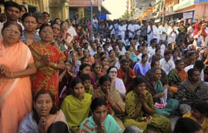 Sai Baba funeral: Devotees wail as they watch the funeral of Sathya Sai Baba