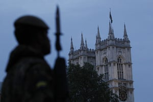 Royal Wedding rehearsal: A member of the British Armed Forces stands guard outside Westminster Abbey