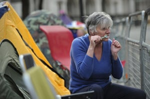 Royal Wedding rehearsal: royal fan brushes her teeth as she camps outside London's Westminster Abbey