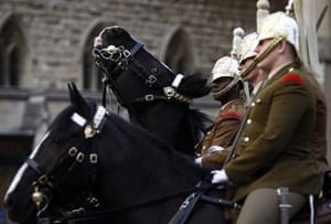 Royal Wedding rehearsal: Soldiers sit on their horses outside Westminster Abbey in London